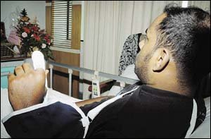 CRUEL ACT: Kumaran showing what is left of his left index finger. — NST picture by Mohd Said Samad.